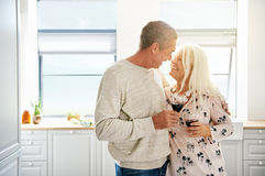 Elderly retired couple sharing a tender moment Royalty Free Stock Image