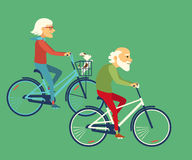 Elderly riding bicycle. Couple riding bikes. Stock Images