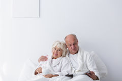Elderly romantic couple in bedroom Royalty Free Stock Image