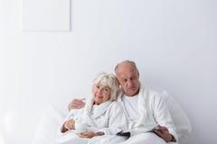 Elderly romantic couple in bedroom Royalty Free Stock Image