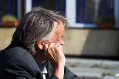 Elderly sad beggar. The elderly beggar experiencing about the problems Royalty Free Stock Photography