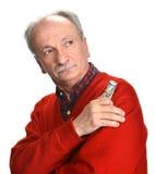 Elderly sad man with dollar bills Stock Photography