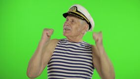 Elderly sailor man funny dances. Old sailorman on chroma key background