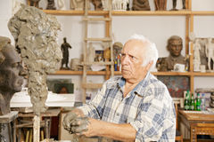 Elderly sculptor making sculpture Royalty Free Stock Photography