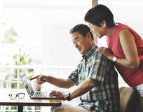 Elderly Senior Couple Computer Home Concept Royalty Free Stock Photos