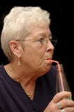 Elderly, senior drinking Stock Photography