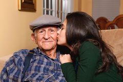 Elderly Senior Grandfather and Teen Granddaughter Royalty Free Stock Image