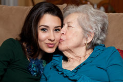 Elderly Senior Grandmother and Teen Granddaughter Stock Image