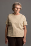 Elderly Senior Happy Portrait on Gray Background Royalty Free Stock Photography