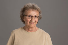 Elderly Senior Happy Portrait on Gray Background Stock Image