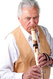 Elderly senior male playing native american flute Royalty Free Stock Photos