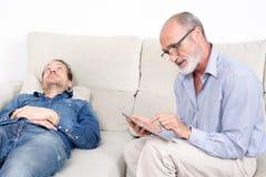 Elderly senior man listening Royalty Free Stock Image