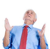 Elderly, senior man with white hair , looking upwards and praying and asking for a miracle Stock Photography