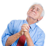Elderly, senior man with white hair , looking upwards and praying and asking for a miracle Stock Photo