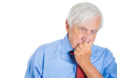 Elderly, senior, mature man in deep thought Royalty Free Stock Photography