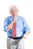 Elderly, senior, mature pissed man placing finger on mouth and saying shhh Stock Photos