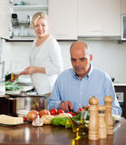 Elderly senior with mature wife doing home chores Royalty Free Stock Photography
