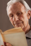 Elderly senior men reading Stock Photos