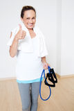 Elderly senior with skipping rope and thumb up royalty free stock images