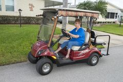 Elderly Senior Woman  Retirement Community  Golf Cart