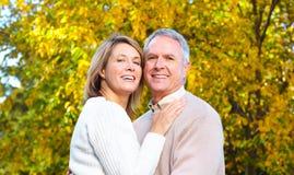 Elderly seniors couple. Happy elderly seniors couple in park stock photo