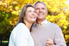 Elderly seniors couple. Happy elderly seniors couple in park royalty free stock images