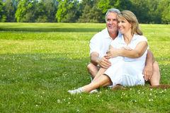 Elderly seniors couple. Happy elderly seniors couple in park stock images