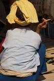 Elderly Shan woman smokes her cheroot Stock Image