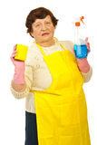 Elderly showing cleaning products Stock Images