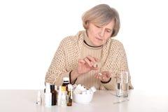 Elderly sick woman Stock Image