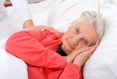 Elderly sick woman Stock Photography