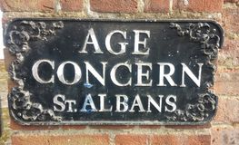 Elderly Sign!. The Irony of an ageing Age Concern Sign Royalty Free Stock Images