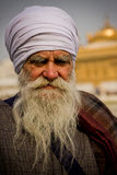 An elderly  Sikh devotee of The Golden Temple of Amritsar, Punjab, India Stock Photo