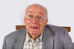 Elderly smart confident man sitting Royalty Free Stock Photo