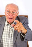 Elderly smart confident man sitting Stock Photo
