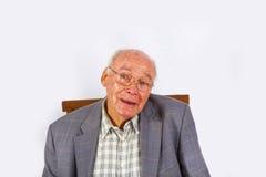 Elderly smart confident man sitting Stock Image