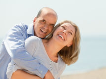 Elderly smiling couple hugging Stock Photos