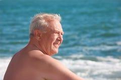 Elderly smiling man on seacoast Royalty Free Stock Photos