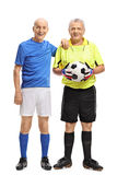 Elderly soccer player and a goalkeeper. Full length portrait of an elderly soccer player and a goalkeeper isolated on white background stock images