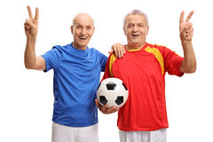 Elderly soccer players making victory signs Stock Images
