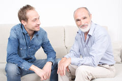 Elderly son with his father. Older son spending some time with his father Royalty Free Stock Photos