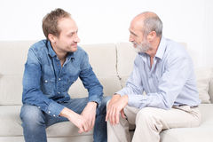 Elderly son with his father. Older son spending some time with his father Royalty Free Stock Images
