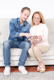 Elderly son with mother. Elderly son showing mother something on the phone royalty free stock photos