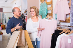 Elderly spouses in boutique Stock Image
