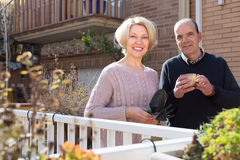 Elderly spouses in patio Royalty Free Stock Photos