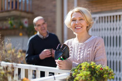 Elderly spouses in patio Stock Photography