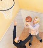Elderly spouses throwing the ball Stock Photos