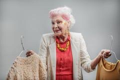 Elderly stylish lady choosing what to wear Royalty Free Stock Photo