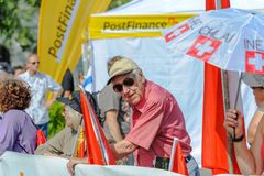 Elderly supporter with sunglasses at the World Orienteering Championships in Lausanne, Switzerland stock image