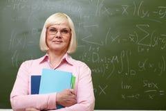 Elderly teacher Stock Image
